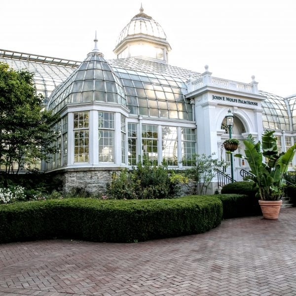 This depicts the Palm House, the historic Victorian era greenhouse. Its many windows and pointed roof architecture makes this an attraction.
