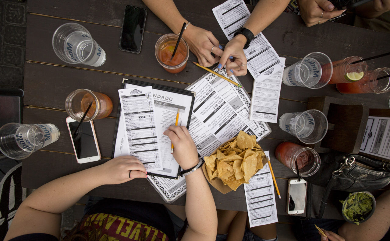 Table at Condado Tacos with chips and menus spread out