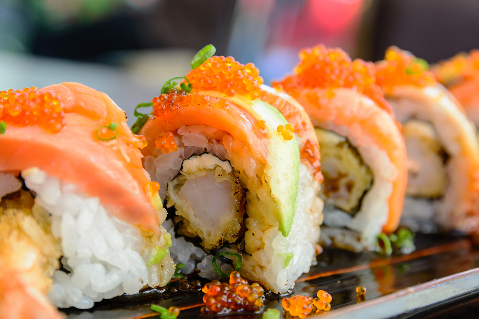 Sushi roll with salmon, avocado, and roe
