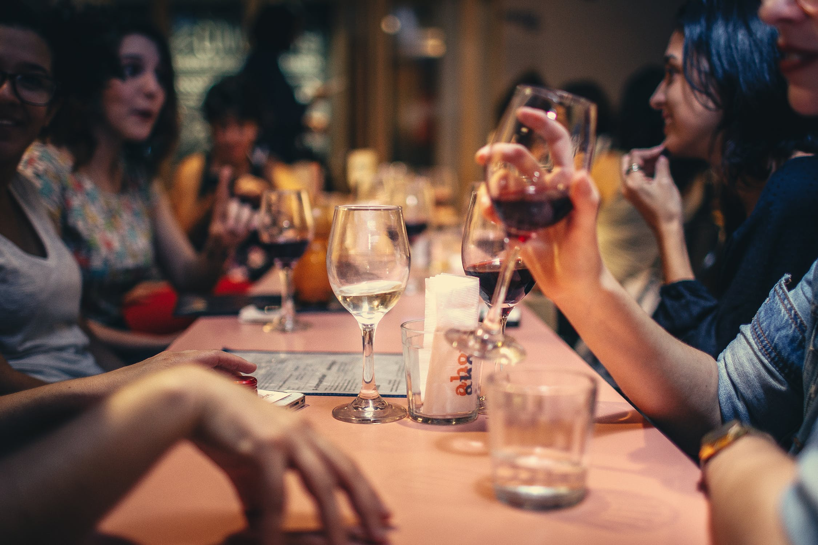 Friends enjoy drinks and food at happy hour