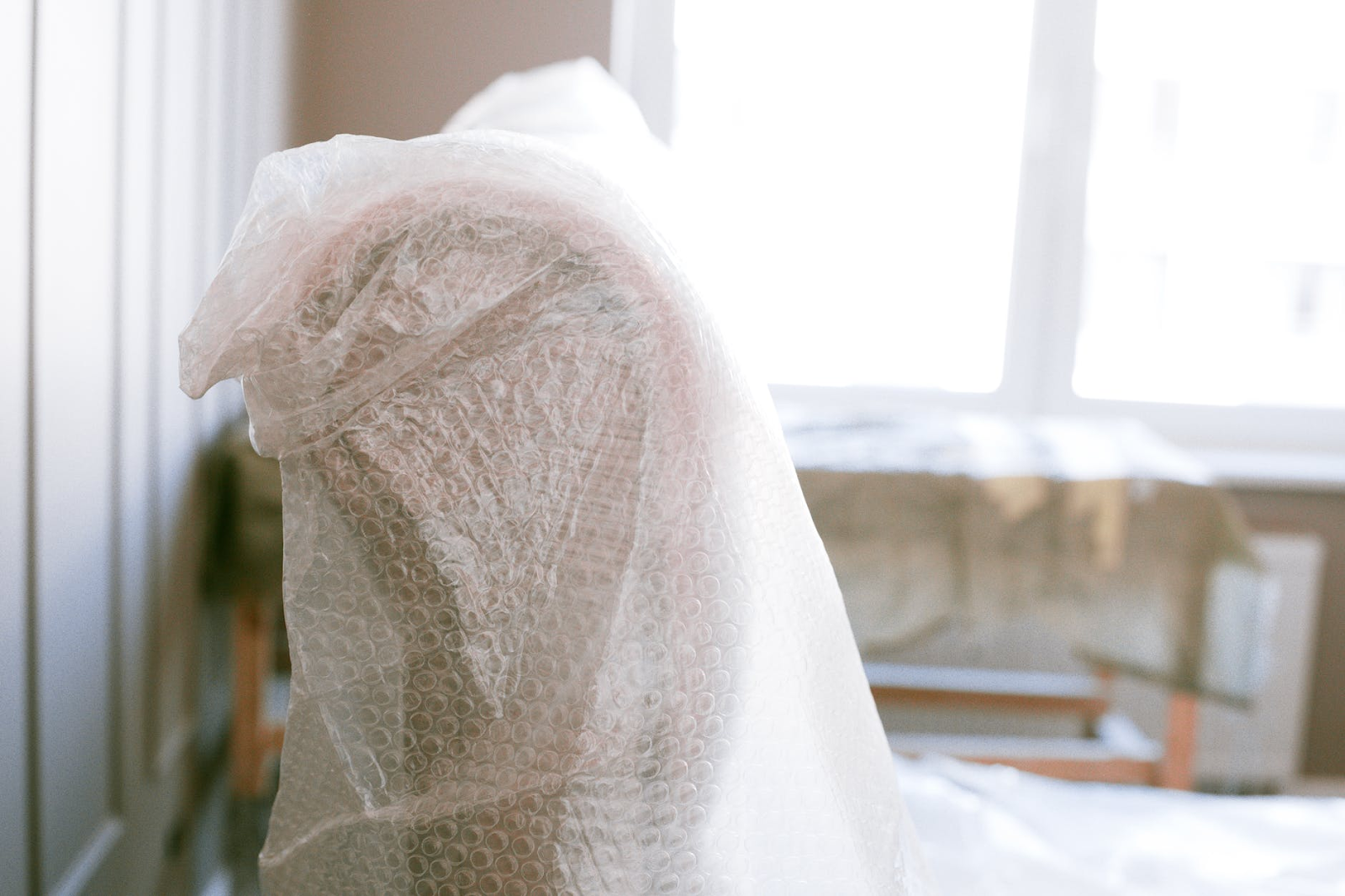 A chair wrapped in bubblewrap