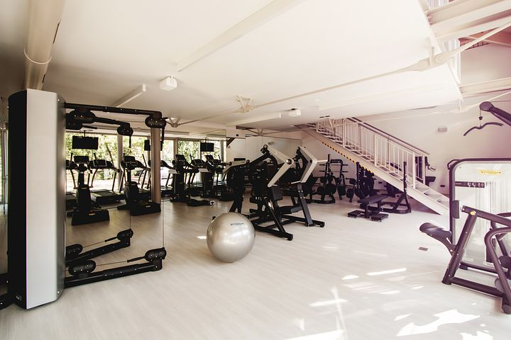 a clean gym with white linoleum floors and white ceilings
