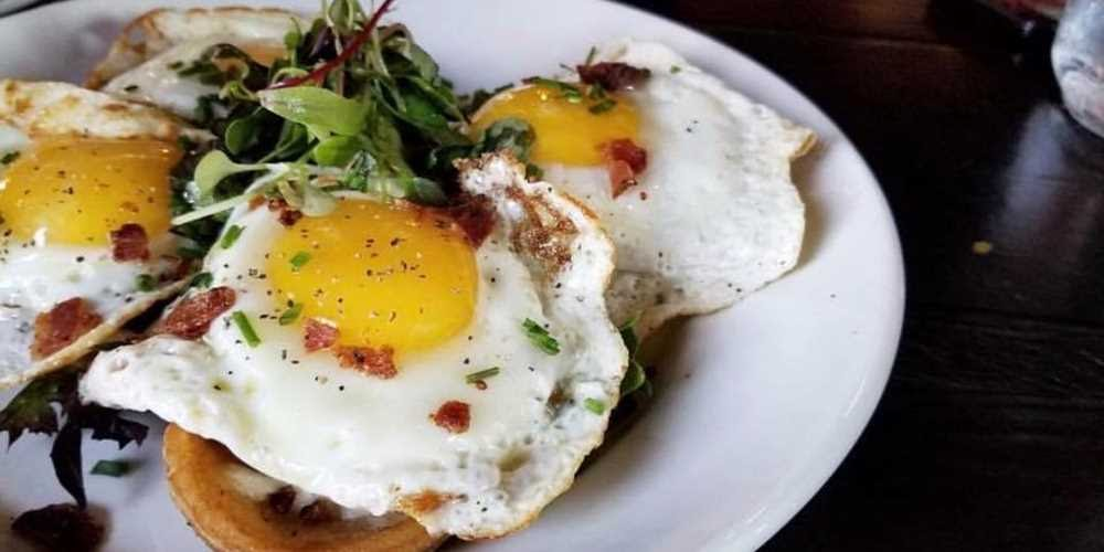 Sunnyside up eggs with greens rom Drunch Eatery in Italian Village.