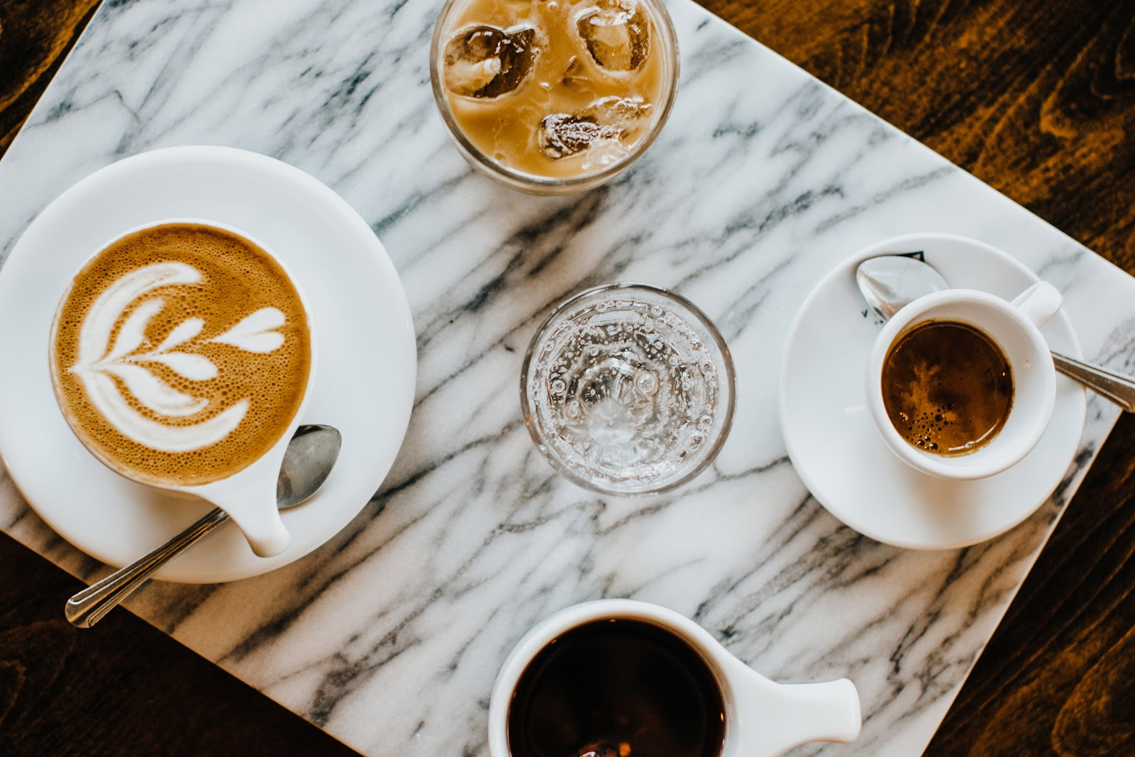 Grab a cup of coffee in Powell Ohio. This image shows a set of different coffees on a table.