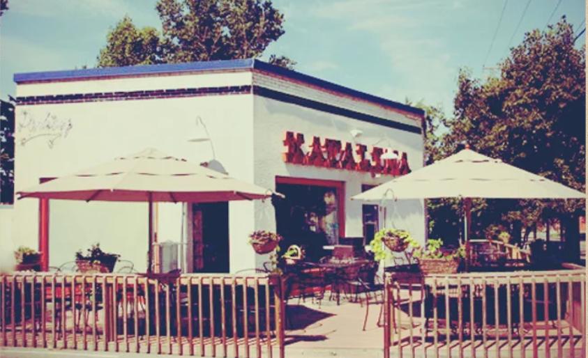 A postcard of Katalina's, a white boxy building