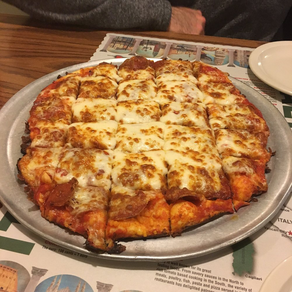 A cheese covered pepperoni pizza from LaPizzeria Restaurant