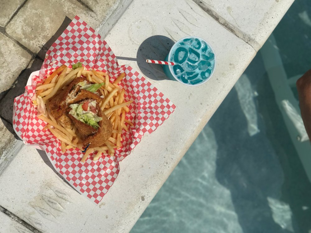 delicious wrap and signature cocktail by the pool