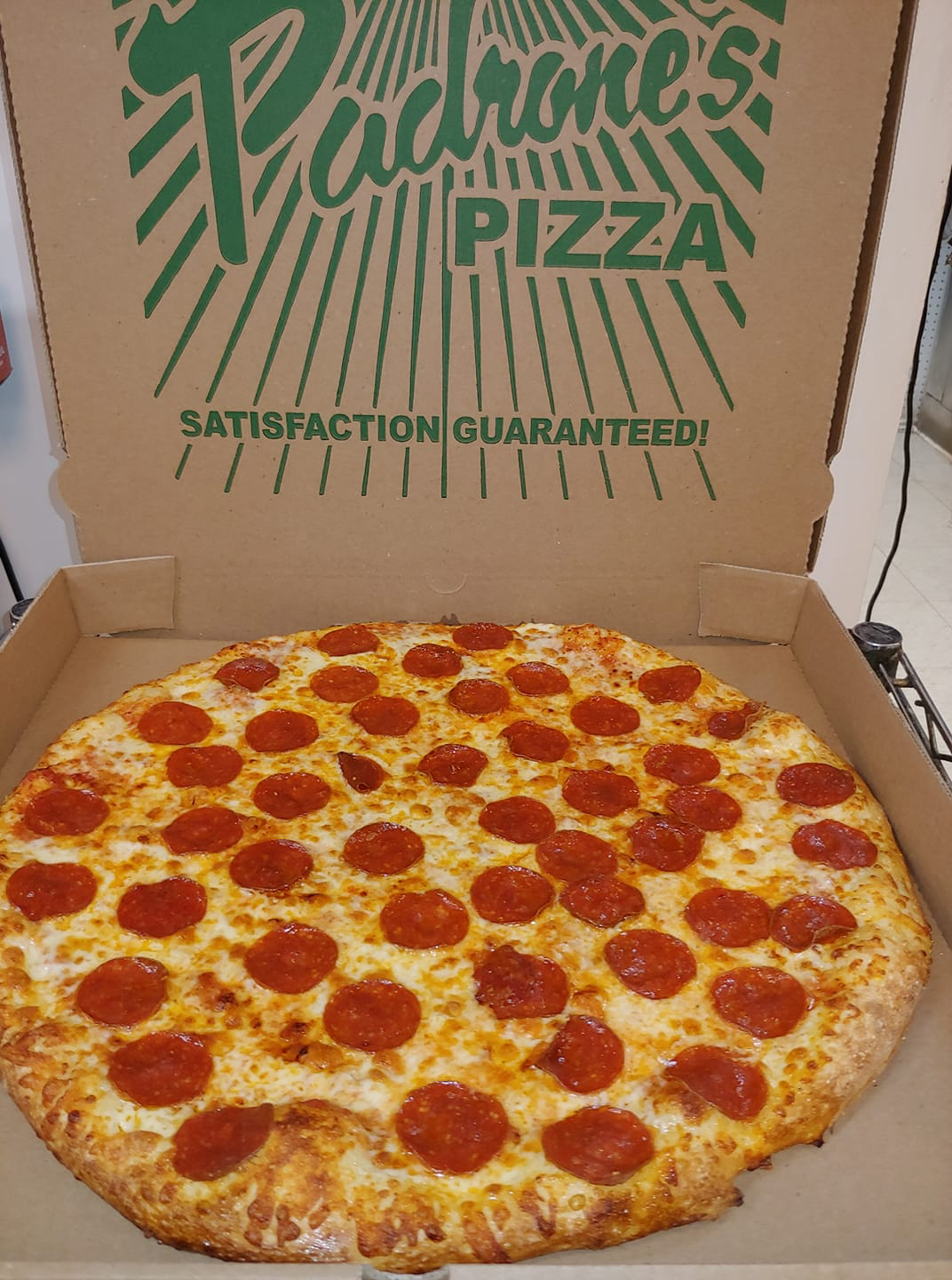 thin crust pepperoni pizza from Padrone's Pizza