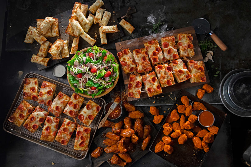 Photo of pizza, wings, and salad from Jet's Pizza