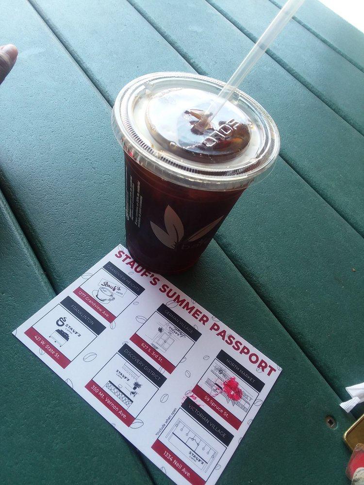 iced coffee with Stauf's Summer Passport next to it.