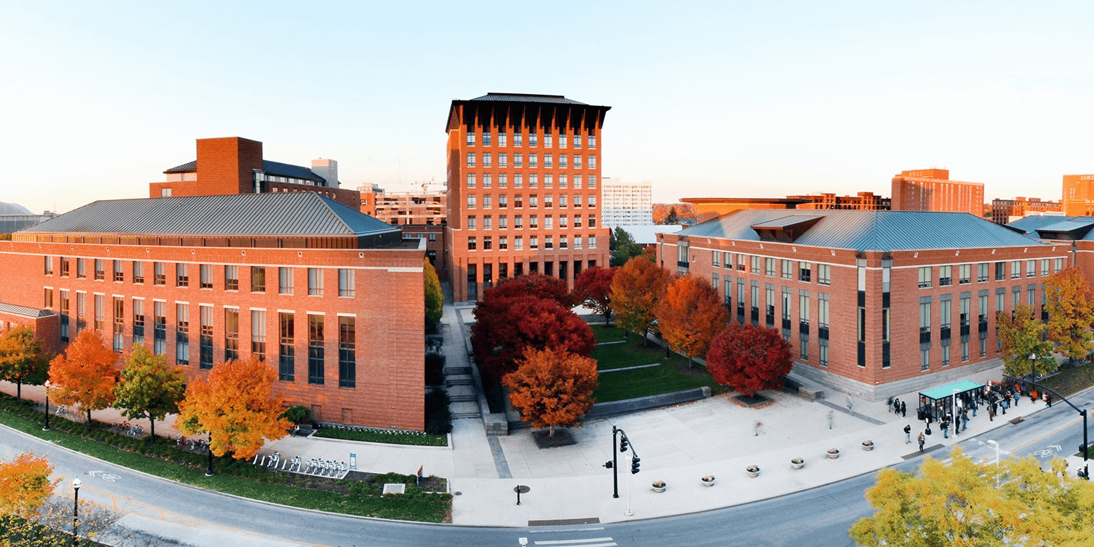 The red brick Ohio State building, surrounded by red and orange trees.