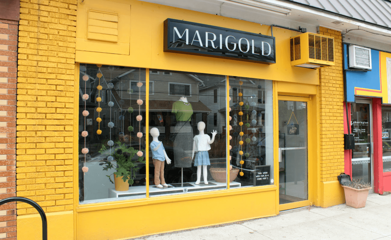 A gold shop with manikins in the window.