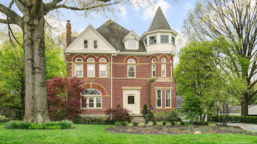 A victorian-style red brick house.