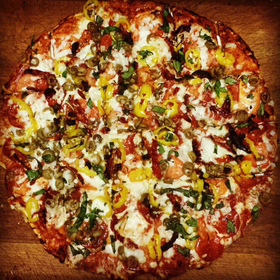 Thin crust pizza loaded with cheese and veggies