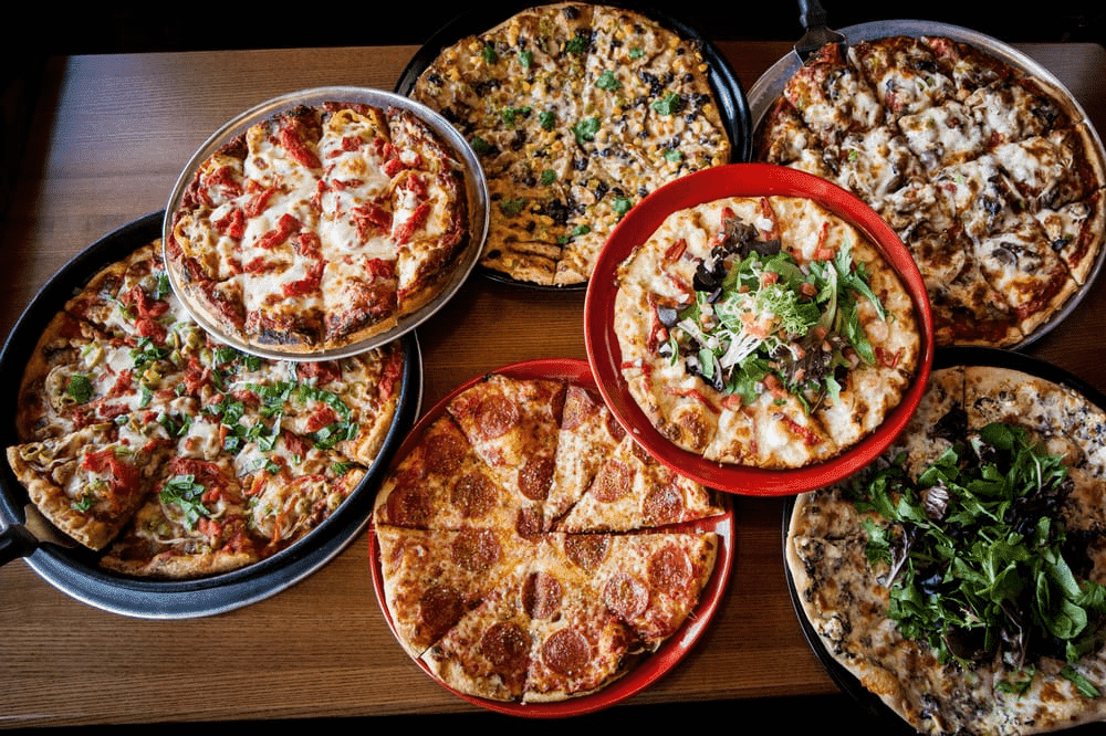 pizzas of different sizes with different toppings