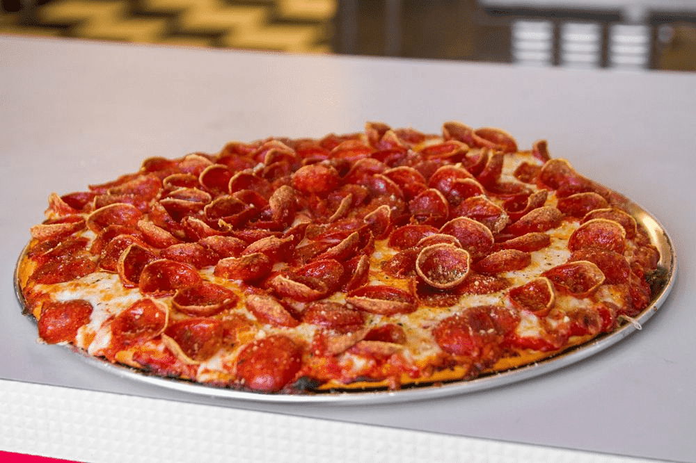 pizza with a lot of pepperoni