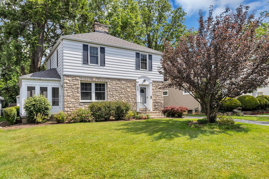 outside image of a two bedroom home. beautiful front yard with landscaping located in Clintonville