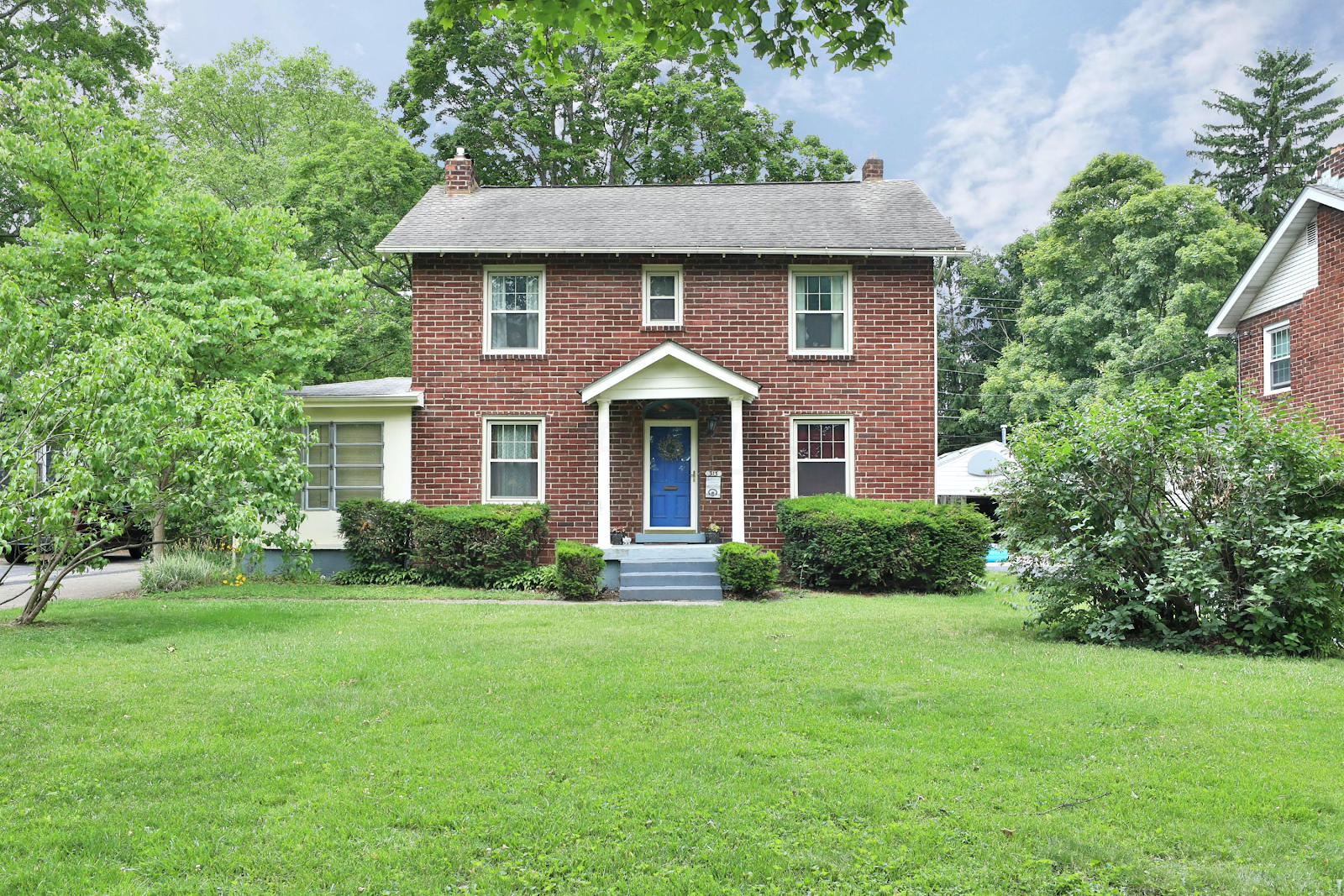 cozy three bedroom home in the heart of Bexley. red brick house and blue front door