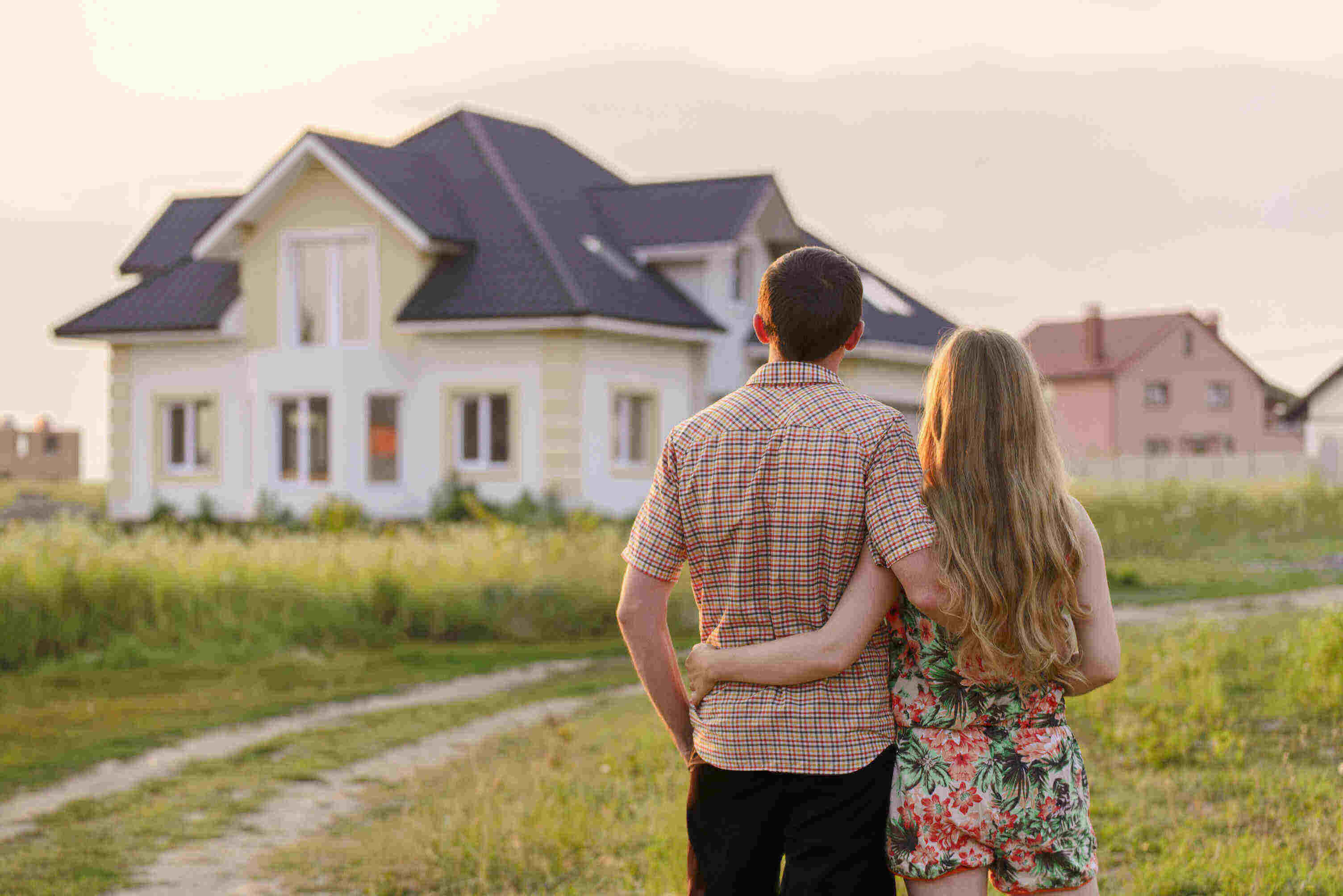 a millennial couple looking at a house