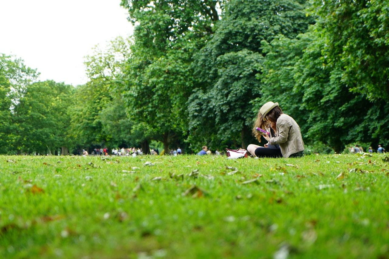 People on a green field
