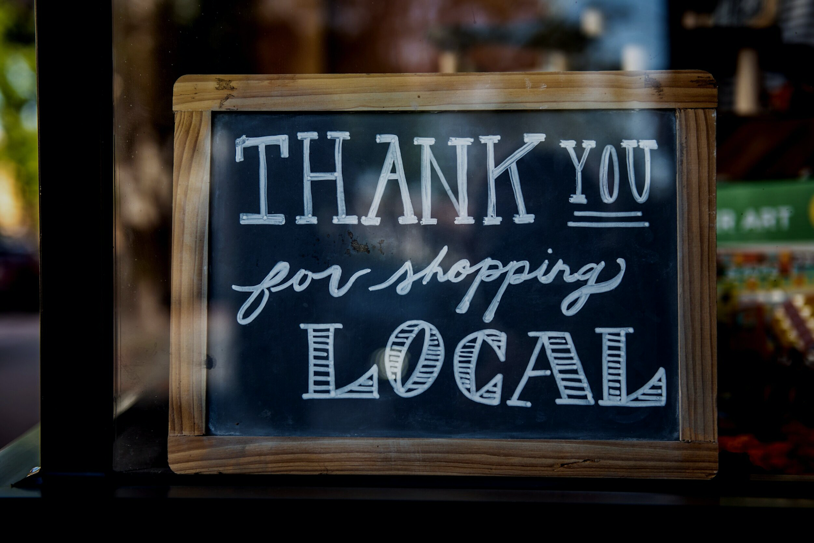 "chalk board sign that says ""thank you for shopping local"""