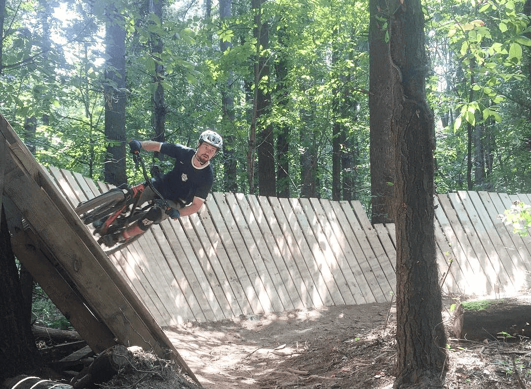 a biker in columbus tackles an off camber wooden platform