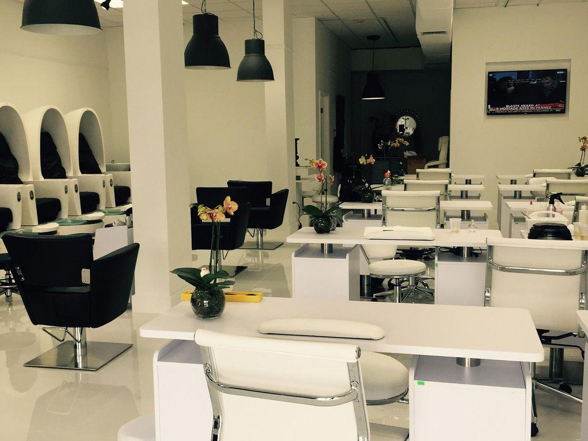 open nail technician tables at a salon