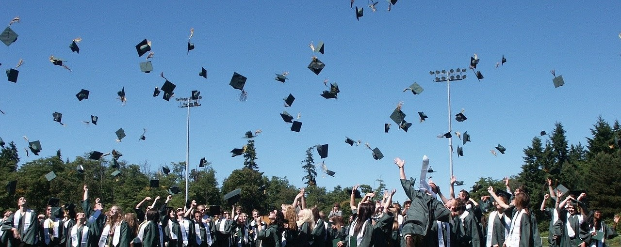 grads throwing their hats in the air