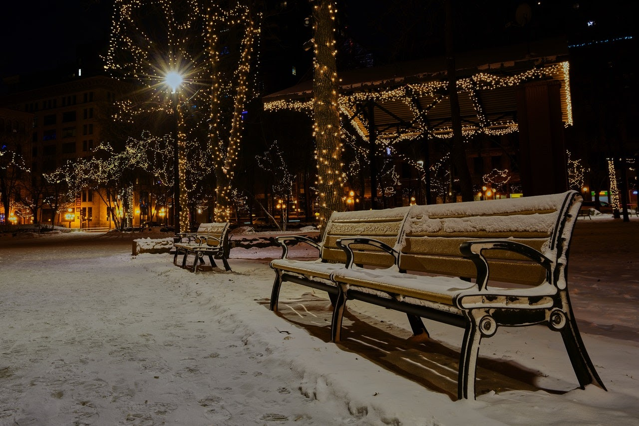 snow covered benches and twinkle lights