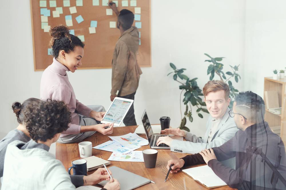 young professionals in office setting working together