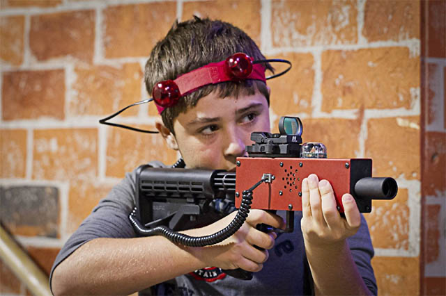 little kid playing laser tag