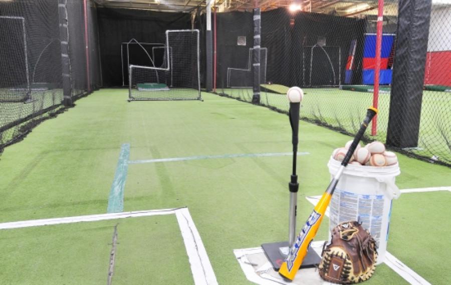 indoor batting cage with green floor