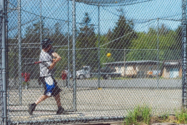 man in an outdoor batting cage