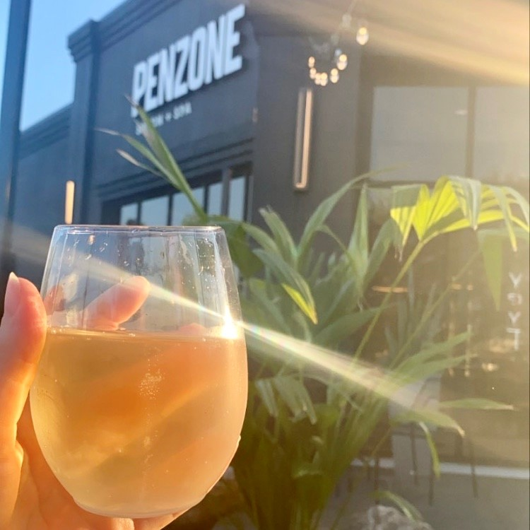 Glass of Wine outside of Penzone Hair Salon