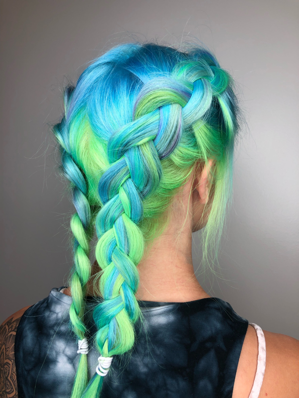 Green and blue hair in boxer braids.