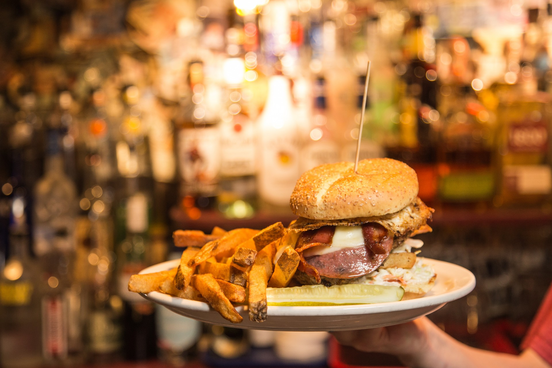 a burger being served at a restaurant in merion village