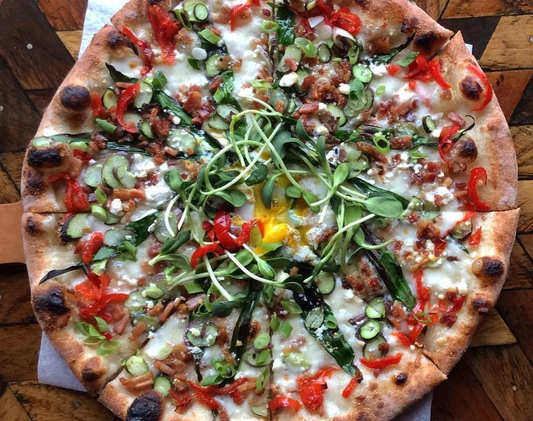 Veggie pizza with pea sprouts