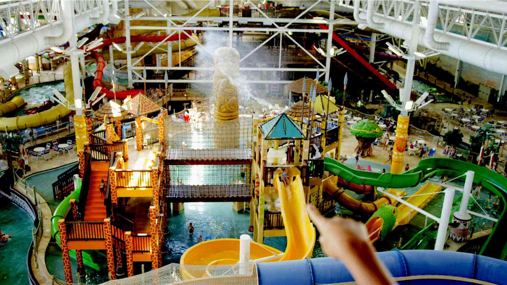 child points at slides in Kalahari waterpark
