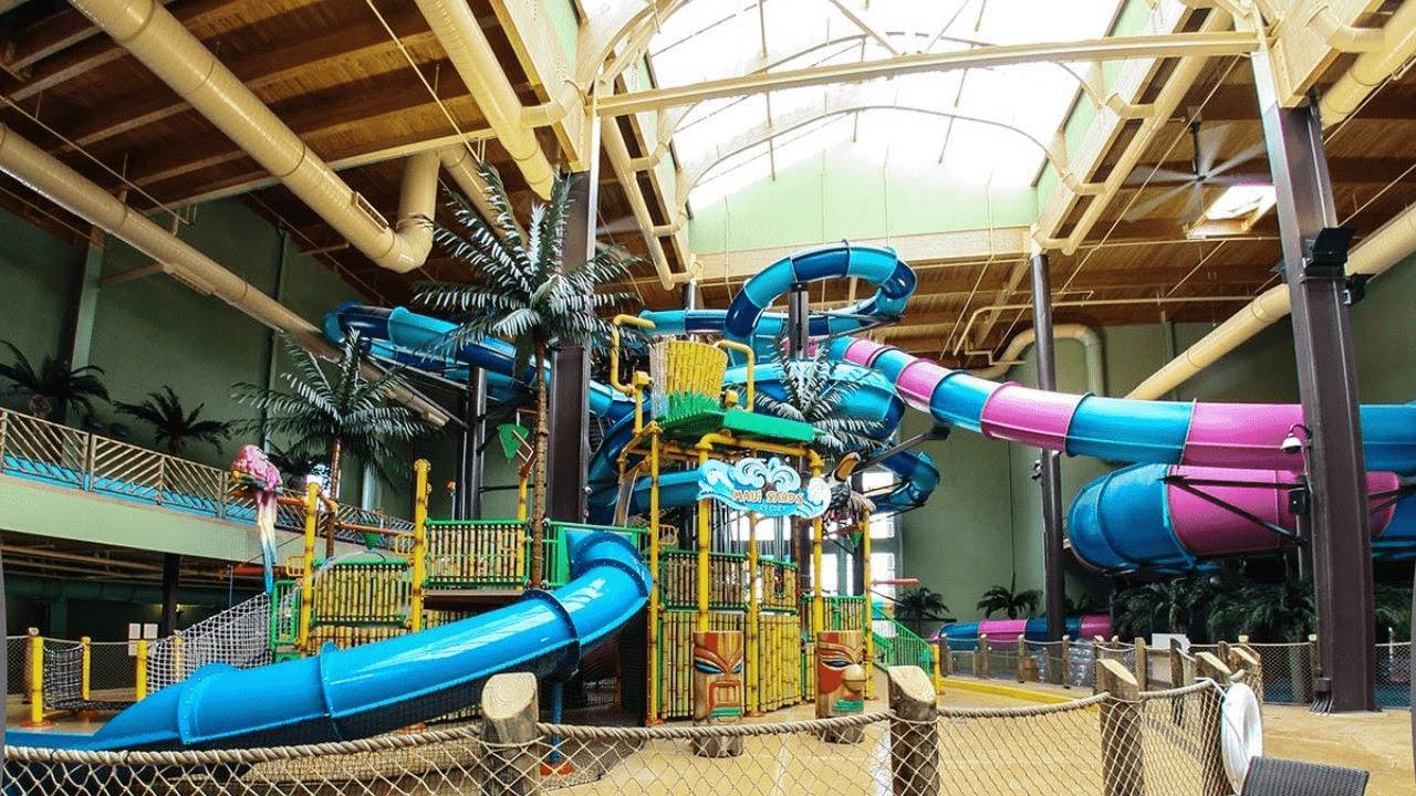 large blue and pink slides in indoor waterpark