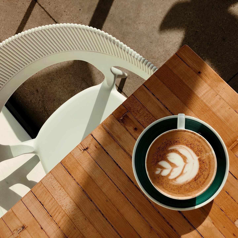 Coffee with a cream leaf