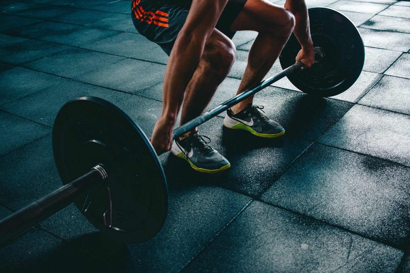 weightlifter preparing to deadlift
