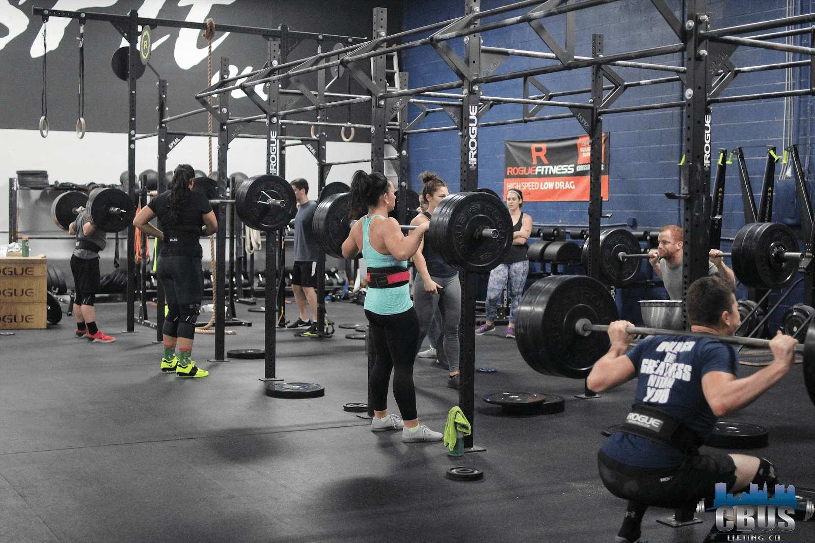 Group of athletes power squatting