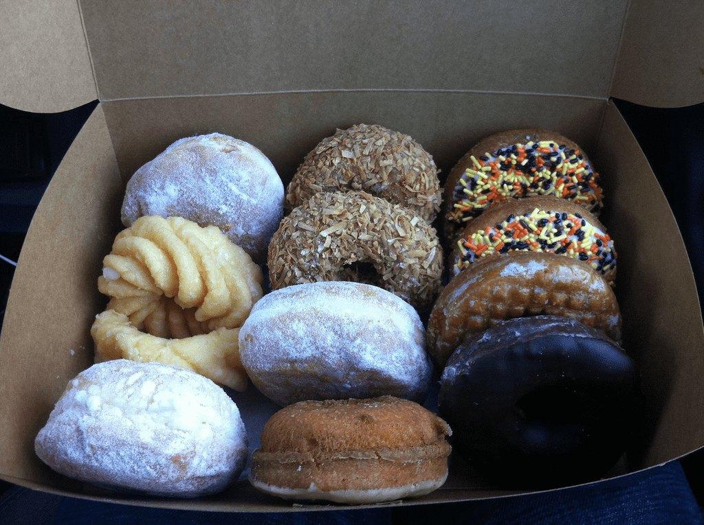 box of a dozen various donuts