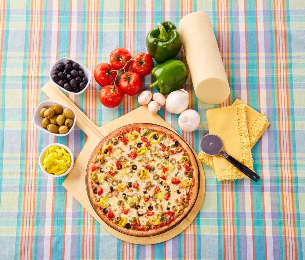 Vegetable Pizza on Plaid Tablecloth