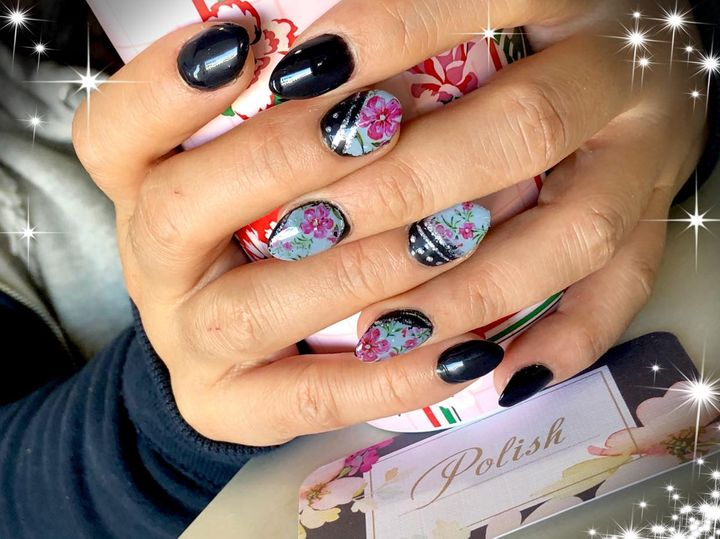 black and pink flowered nails