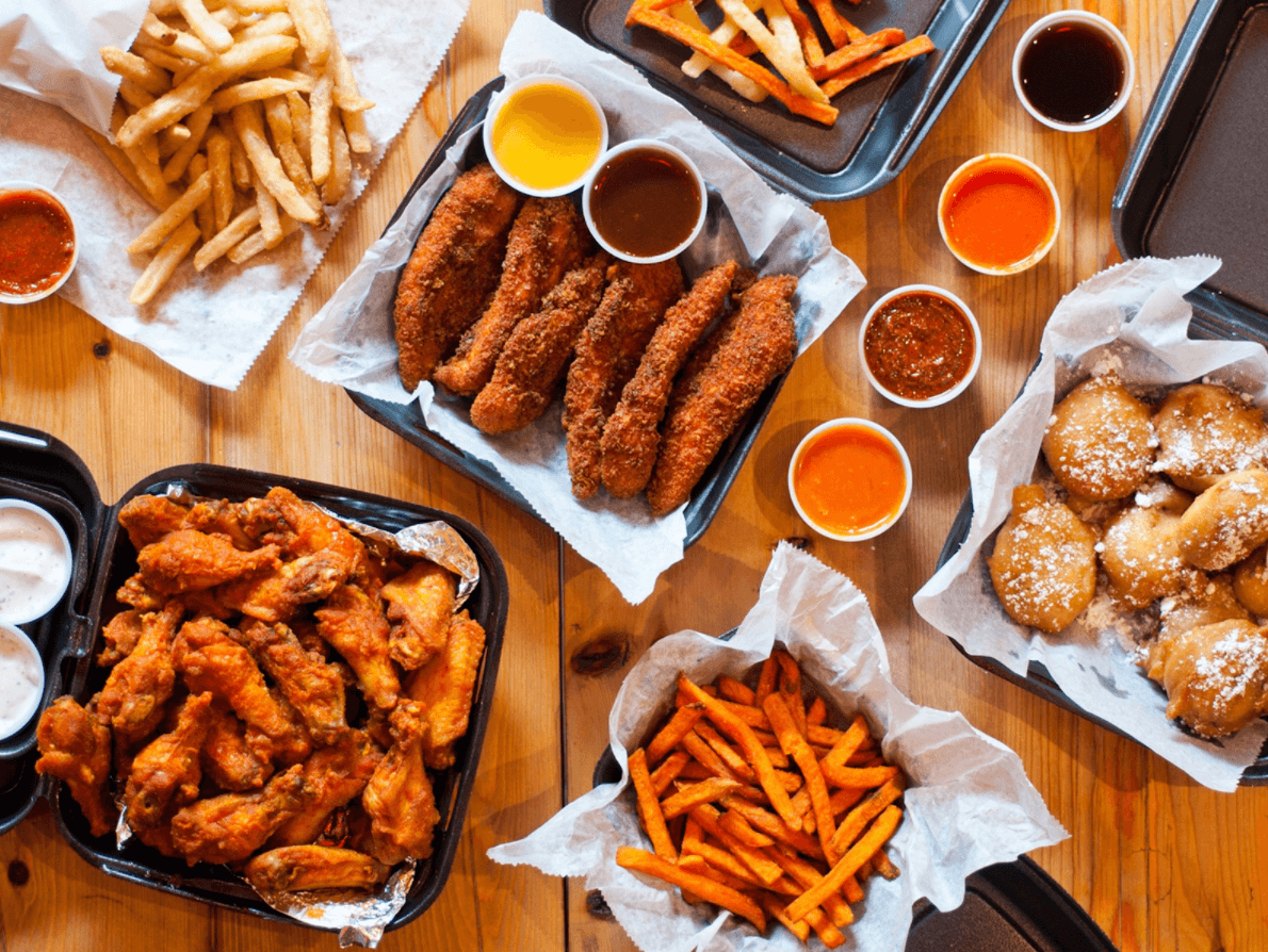 Chicken wings and french fries available for delivery in Rooster's. Image Courtesy of Uber Eats.