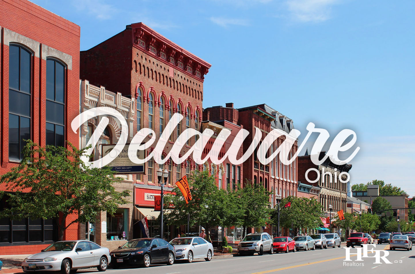 an aerial view of the town of delaware ohio on a sunny day