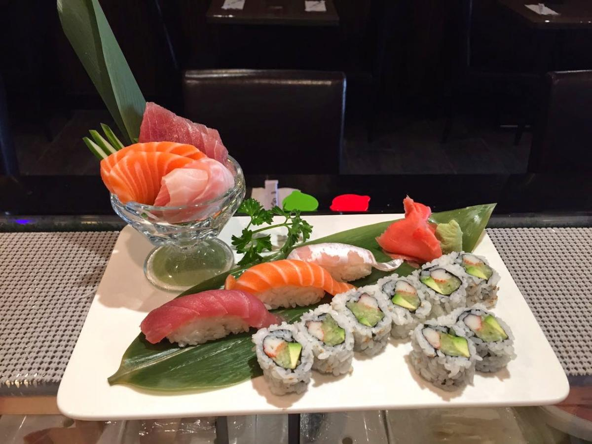 Plate of sashimi and sushi roll