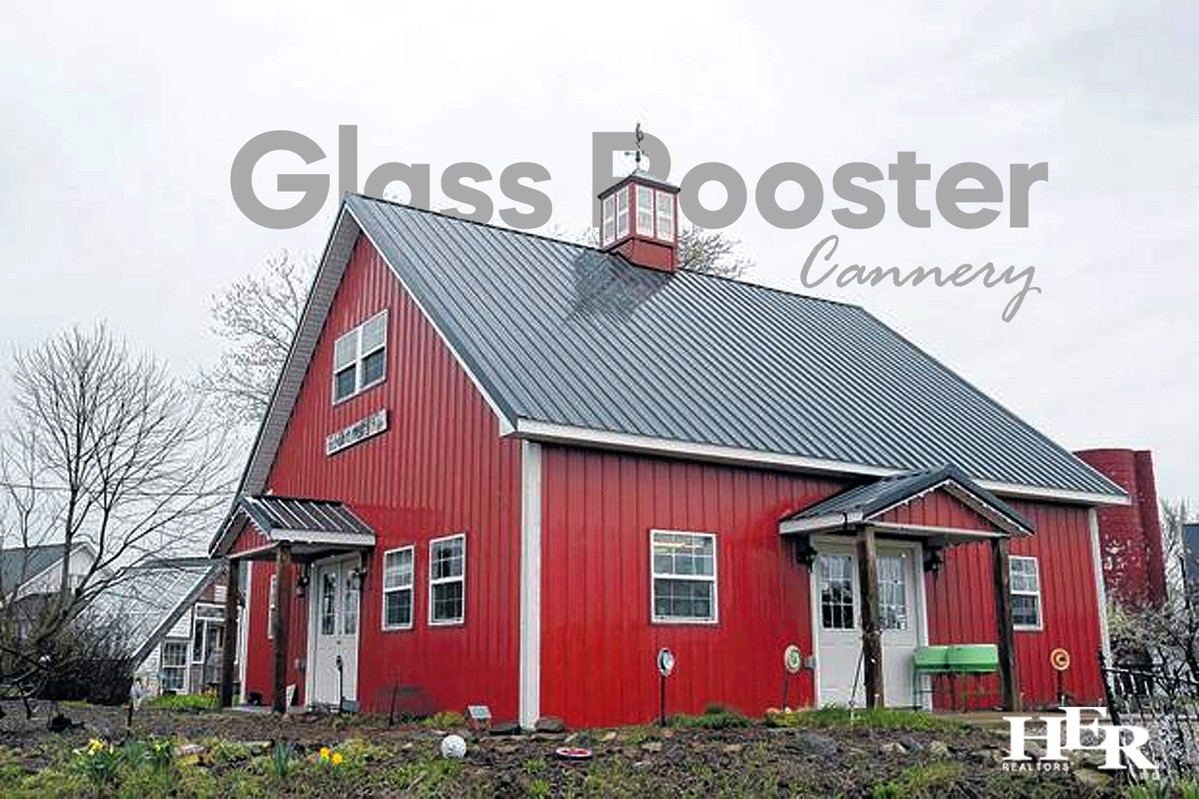 Glass Rooster Cannery, red building with blue roof