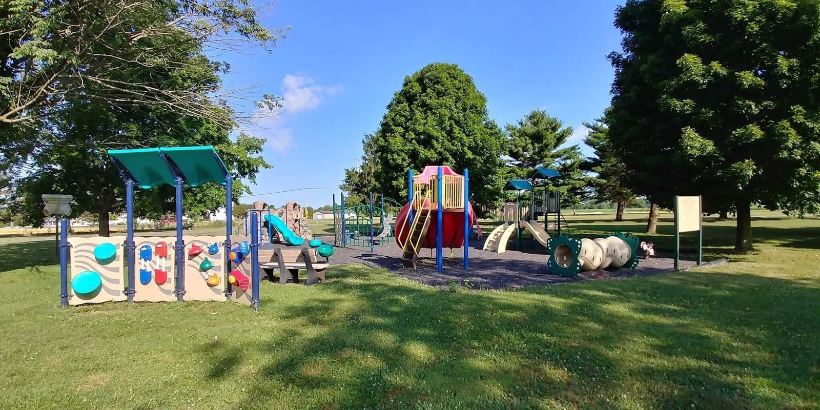 Playground with jungle gym and slides